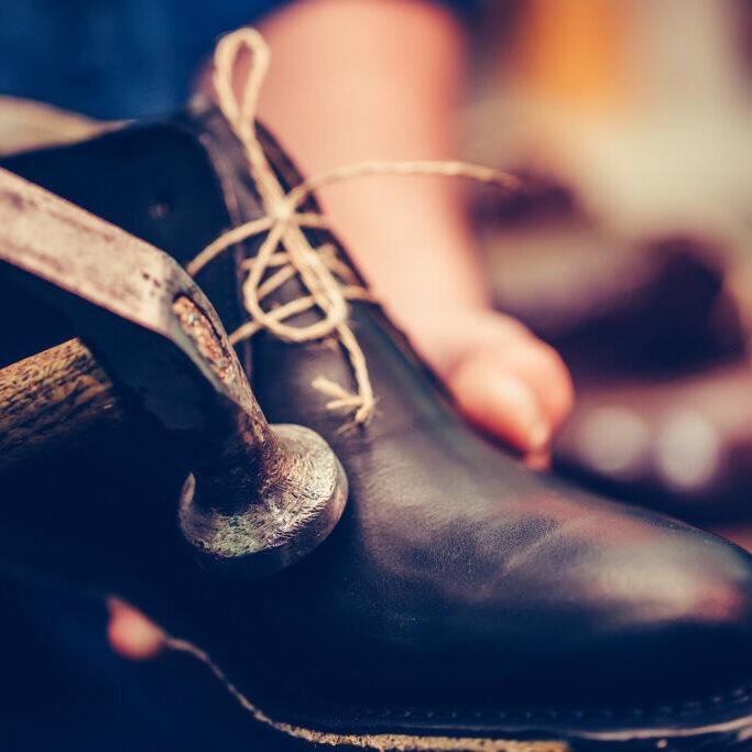 man making shoes